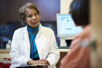 MSK breast cancer specialist Diana Lake talks to a patient about clinical trials