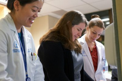 MSK physician Aimee Crago consults with two colleagues.
