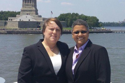 Memorial Sloan Kettering ovarian cancer patient Vilma Rosario and her partner, Michele Freeman, pose at the Statue of Liberty.