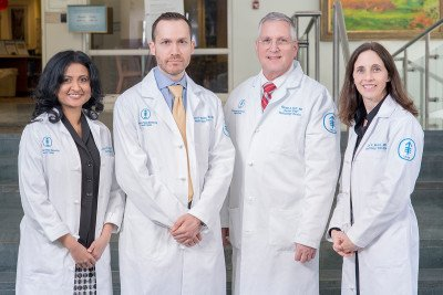 MSK hematologists Rekha Parameswaran, Simon Mantha, Gerald A. Soff, and Jodi V. Mones stand together in lab coats.