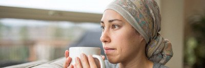 Young female cancer patient holding a tea cup