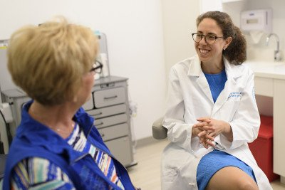 A female doctor talking to a female patient