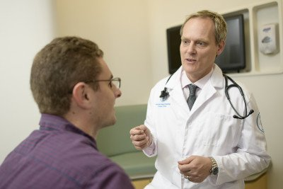 MSK hematologic oncologist doctor Ola Landgren pictured with a patient