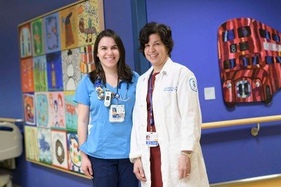 Gabriella and Roseann Tucci pose on a Pediatrics floor