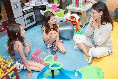 MSK acting teacher Jenny Solomon with two children