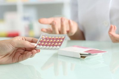 A woman considering birth control pills