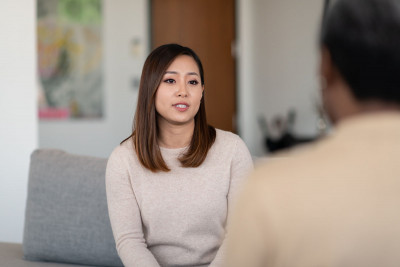 A woman meets with her therapist.