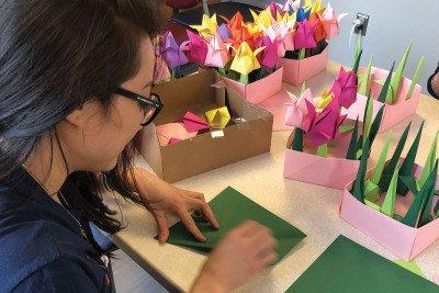 Vanessa Tran folding paper cranes