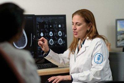 Neurosurgeon Viviane Tabar looks at a brain scan