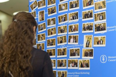 Guests viewing a photo board at the 2016 BMT Celebration.