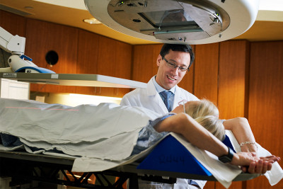 MSK's radiation oncologist, Andreas Rimner, providing radiation to a female lung cancer patient.