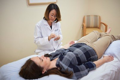 Medical oncologist Ting Bao offers acupuncture to her patients to help alleviate the side effects of cancer treatment.