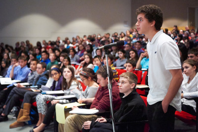 A student asks a question at last year's