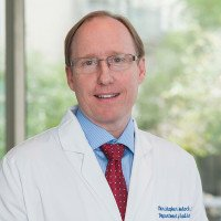 Christopher E. Comstock, MD