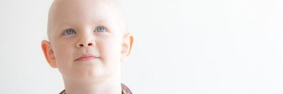 child with cancer looking up