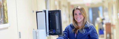 Nurse sits at computer
