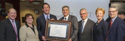 MSK and Hartford leadership holding certificate