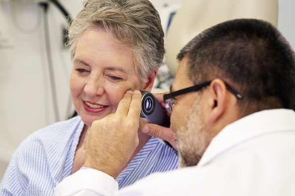 MSK doctor conducting cancer screening and risk assessment