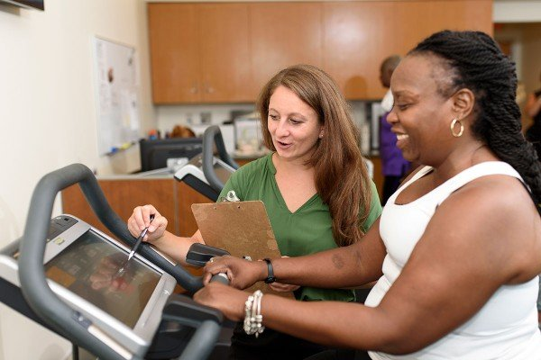 Pictured: Exercise physiologist supervisor Meghan Michalski with a patient