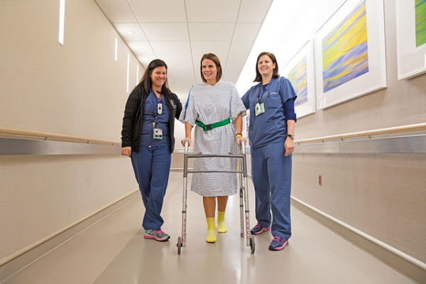 MSK physical therapist Amanda Molnar and occupational therapist Nicole Kasven-Gonzalez aid a patient.
