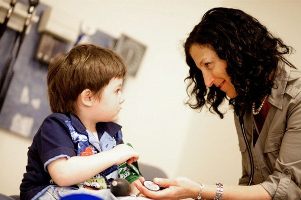 Pediatric oncologist Susan Prockop with a young patient.
