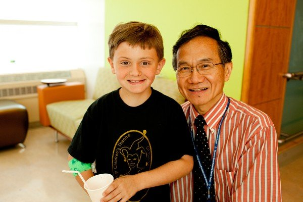 Neuroblastoma patient Jeremy D. with his doctor, pediatric oncologist Nai-Kong Cheung