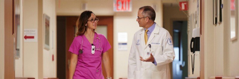 MSK surgeon Julio Garcia-Aguilar and nurse Gina Occhiogross walk down a hallway