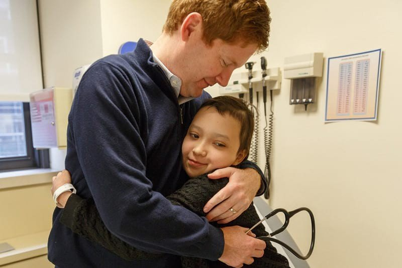 Pediatric oncologist Kevin Curran with patient Esmeralda Pineda