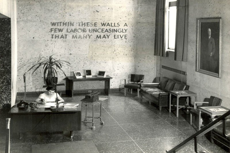 A view of the SKI lobby in 1949. The inscription reads: Within These Walls A Few Labor Unceasingly That Many May Live.