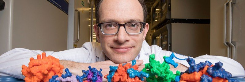 MSK chemist Daniel Heller with models of his nanoparticles
