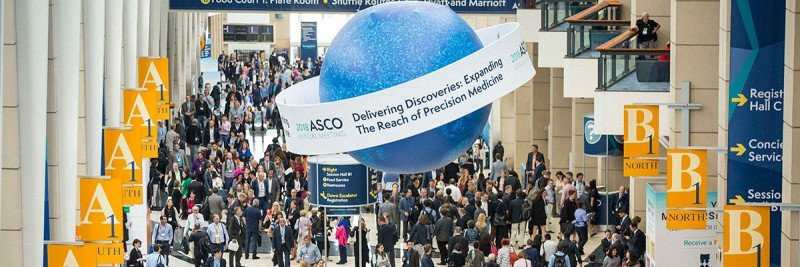 Crowded hall with ASCO signage