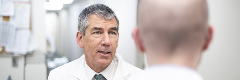 Urology Service Chief James Eastham talks to a patient