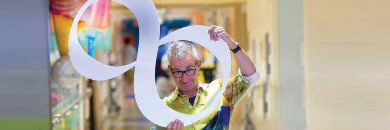 JJ Boelens holding large number 8