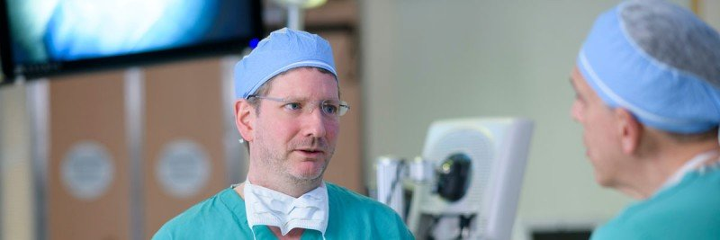 Neurosurgeon Cameron Brennan prepares in the operating room.