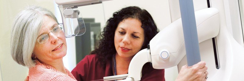 A patient receives a mammogram, which can determine if she has dense breast tissue