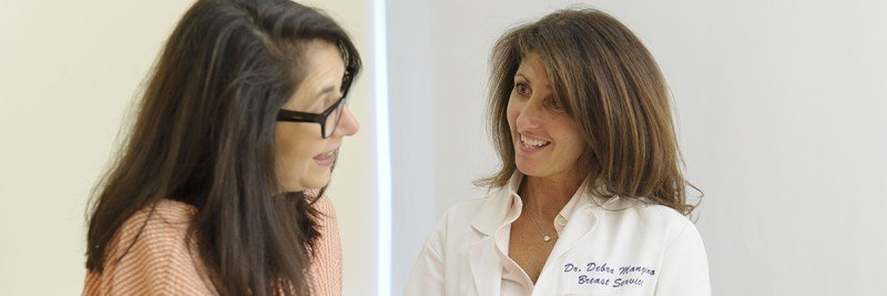 RISE Program Clinical Director Debra Mangino discusses next steps with a patient.