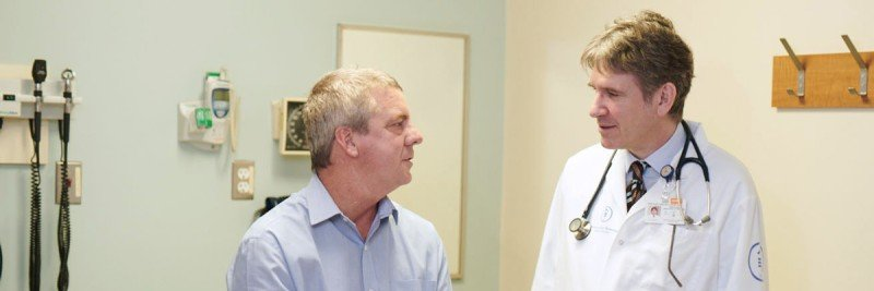 Medical oncologist Miguel-Angel Perales with a patient.